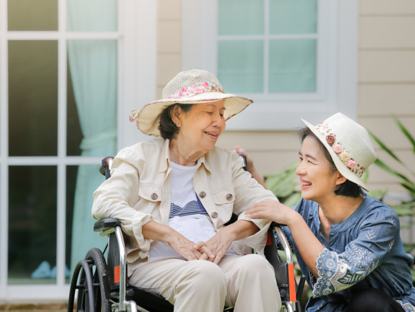 young woman and elderly smiling