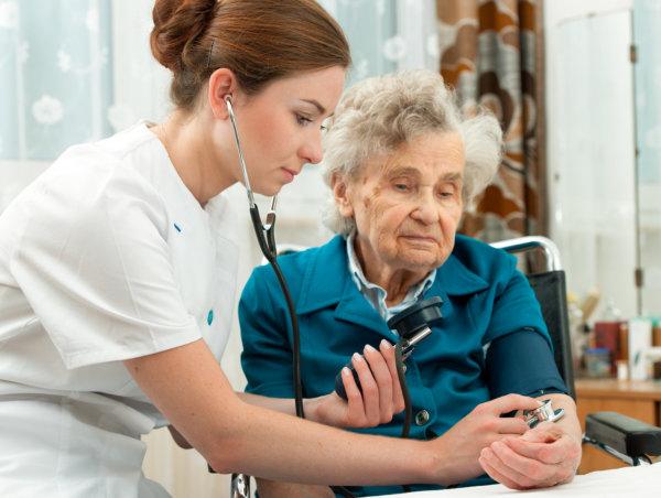 Nurse checking on elderly