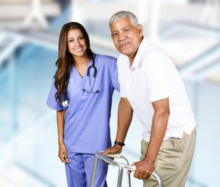 nurse and man in crutches smiling