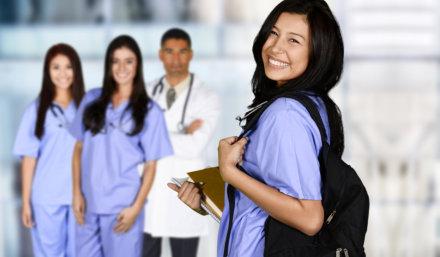 nurse carrying her bag smiling