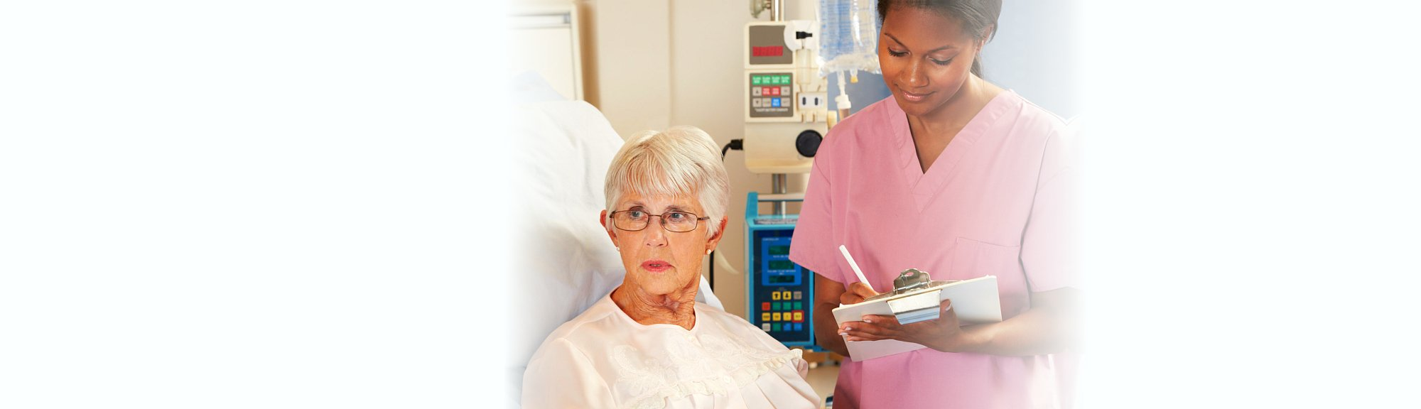 nurse interviewing the senior woman