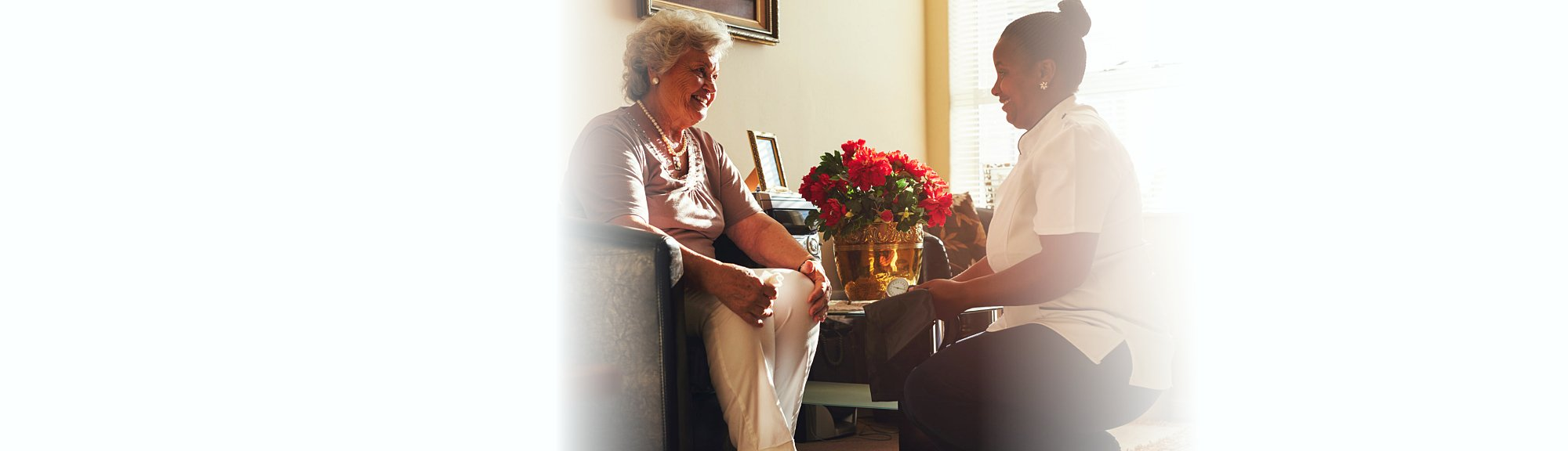 nurse smiling to the senior woman