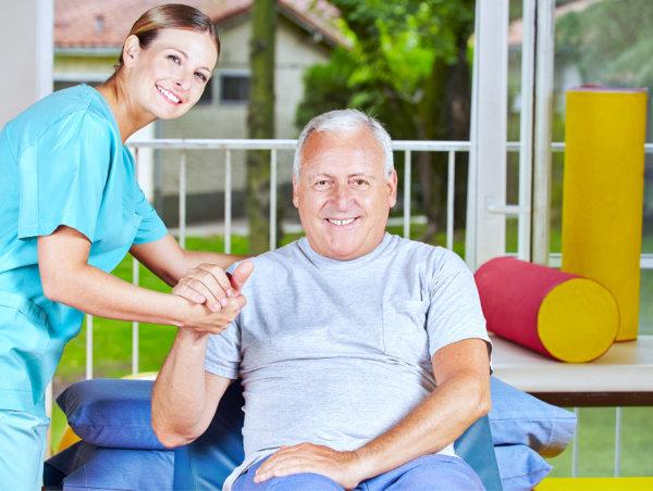 caregiver helping an elderly