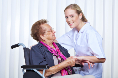 Our Care Experts | A nurse and an old women in a wheelchair