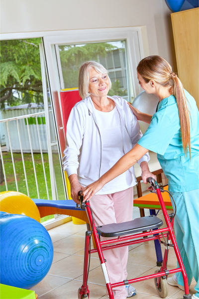 Physiotherapist explaining the use of a walker to a senior woman