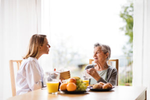woman reminding an elderly woman