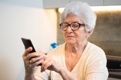 old woman answering the phone call