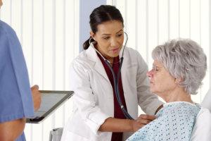 nurse checking the condition of an elderly