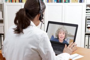 woman talking to a elderly woman